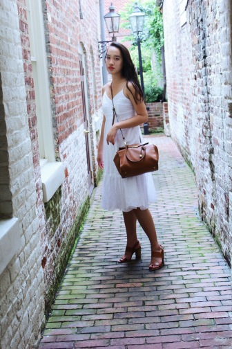 White broderie anglais midi-dress and block heels.